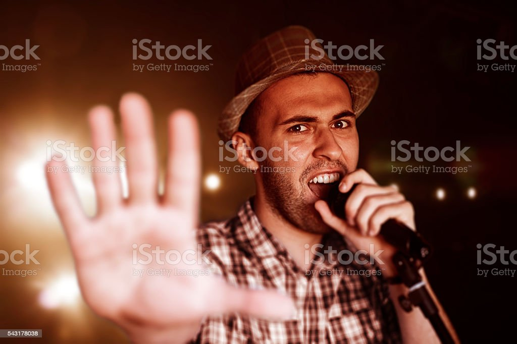 Man singing with hand outstretched stock photo
