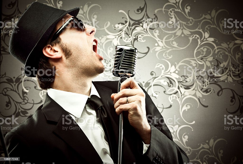 man singing with microphone royalty-free stock photo