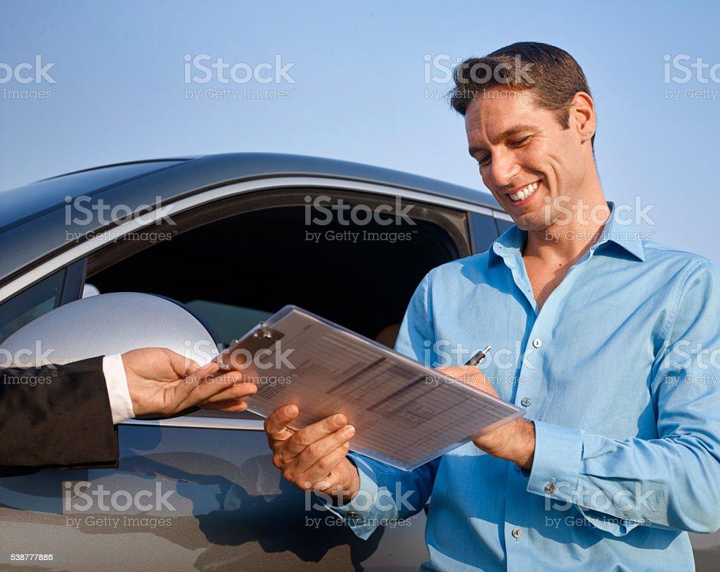 Man sings the rental car form stock photo