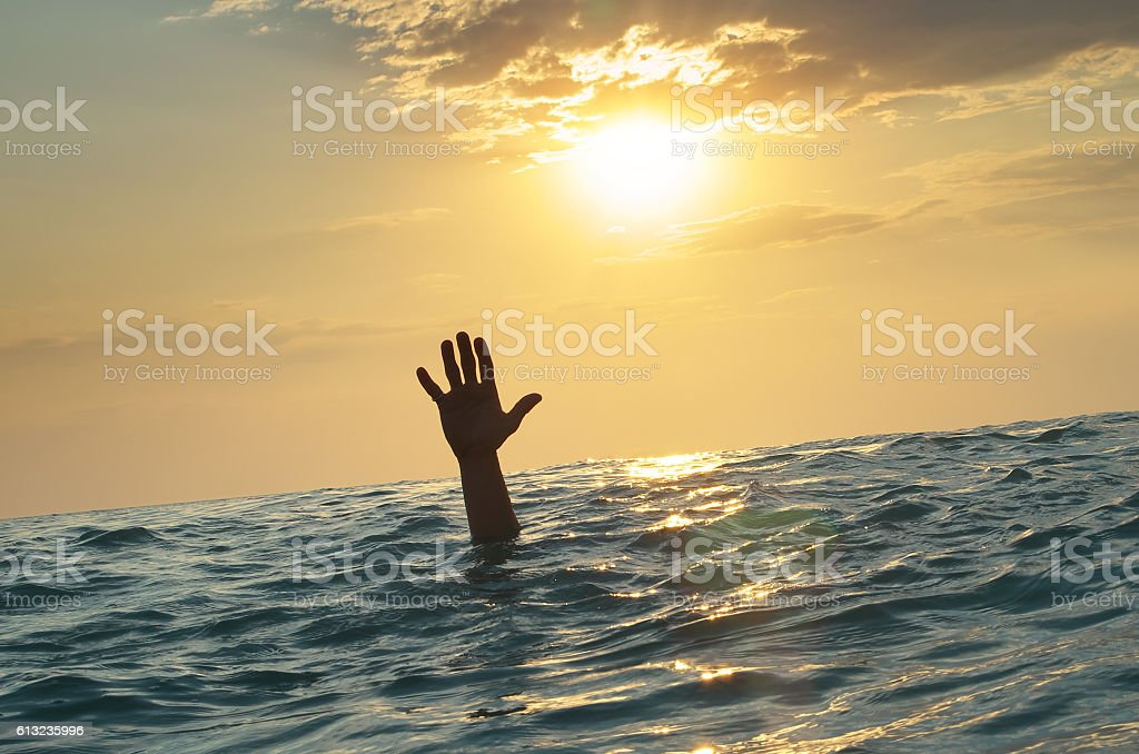 Man sink in water stock photo