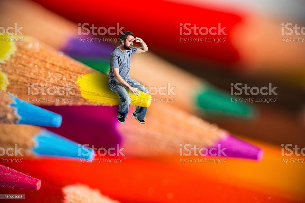 Man sit on crayons looking out royalty-free stock photo