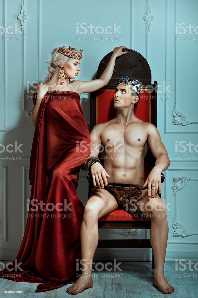 Man sits on the throne and looks at queen. stock photo