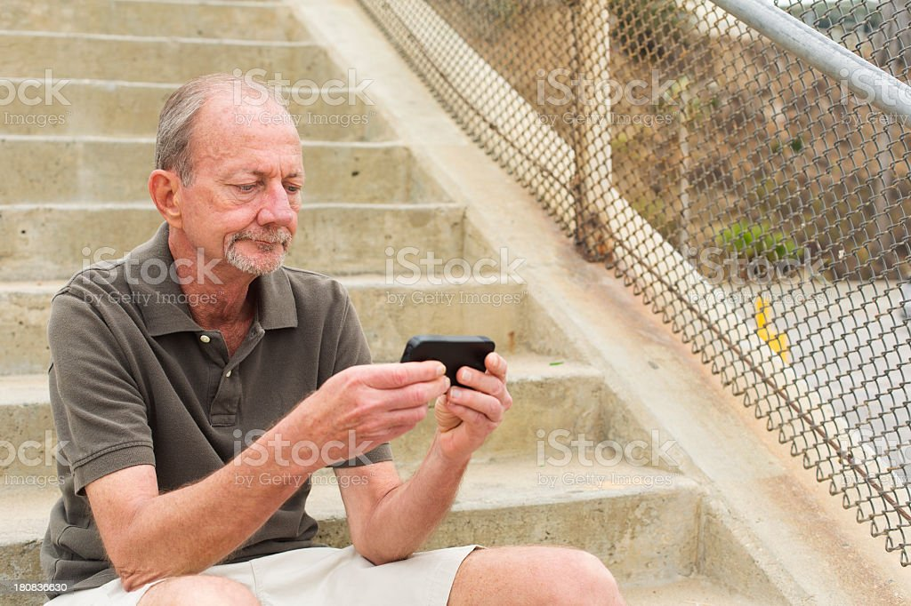 Man Sitting and Texting royalty-free stock photo
