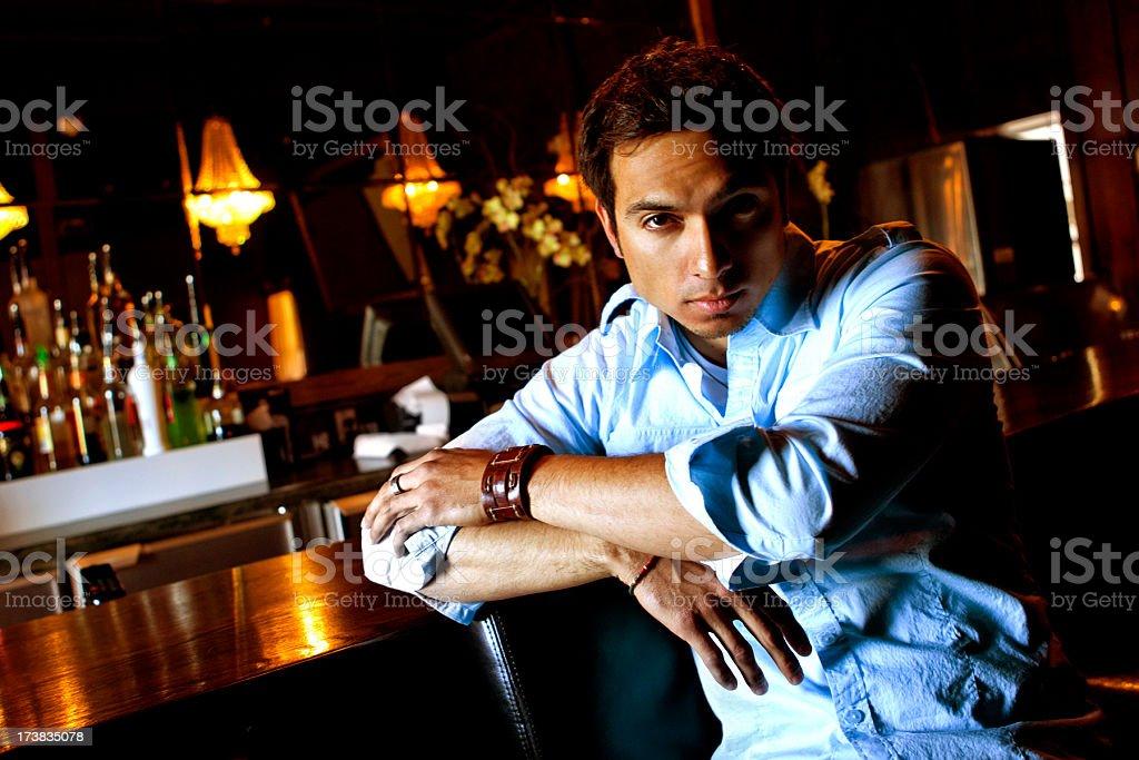 Man Sitting at a Bar stock photo