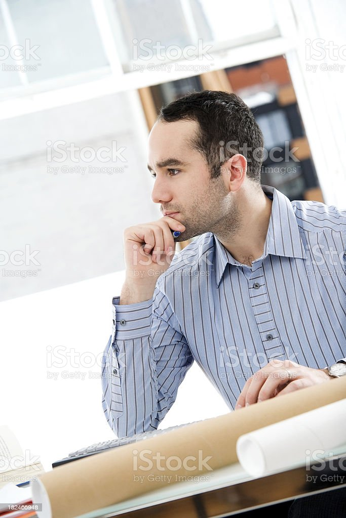 Man Sitting at a Desk Working royalty-free stock photo