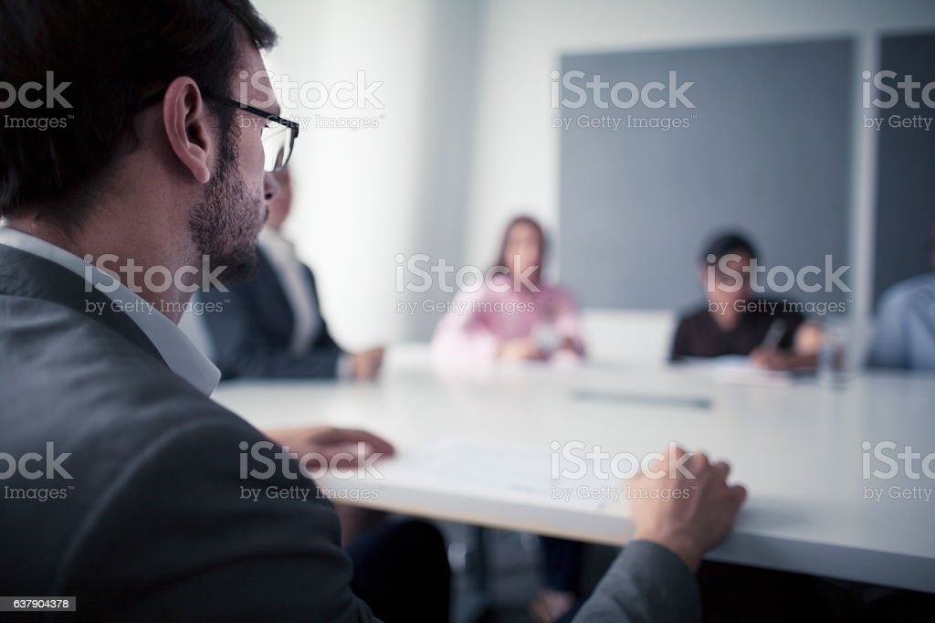 Man sitting at business meeting office table stock photo