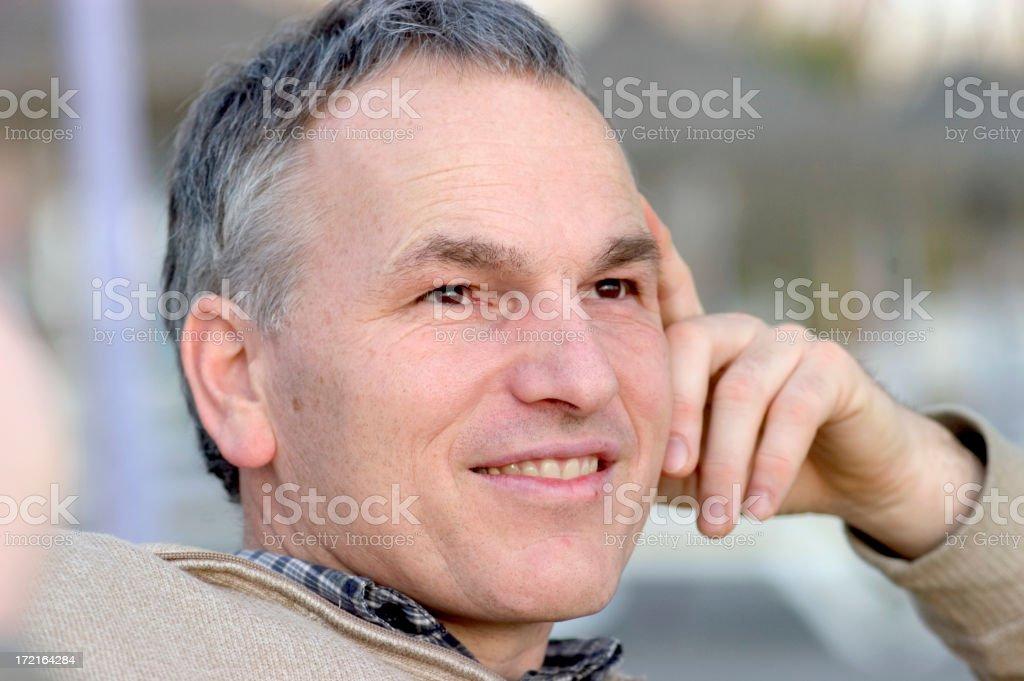 Man sitting at he beach royalty-free stock photo