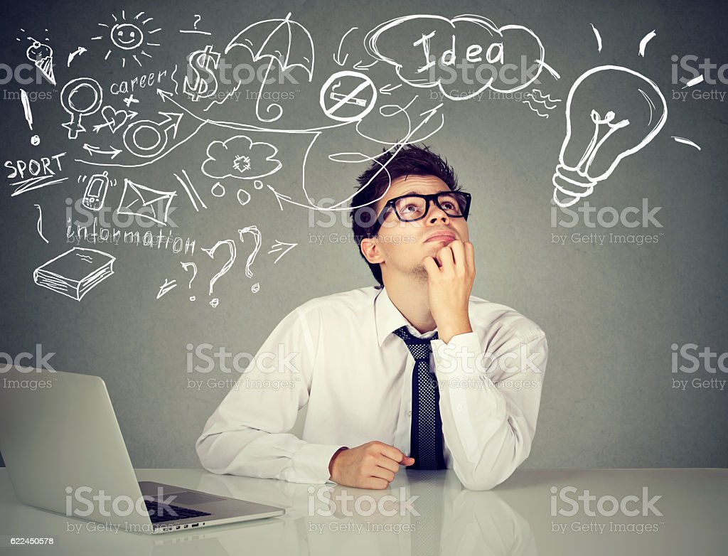 man sitting at table with laptop many ideas planning future stock photo
