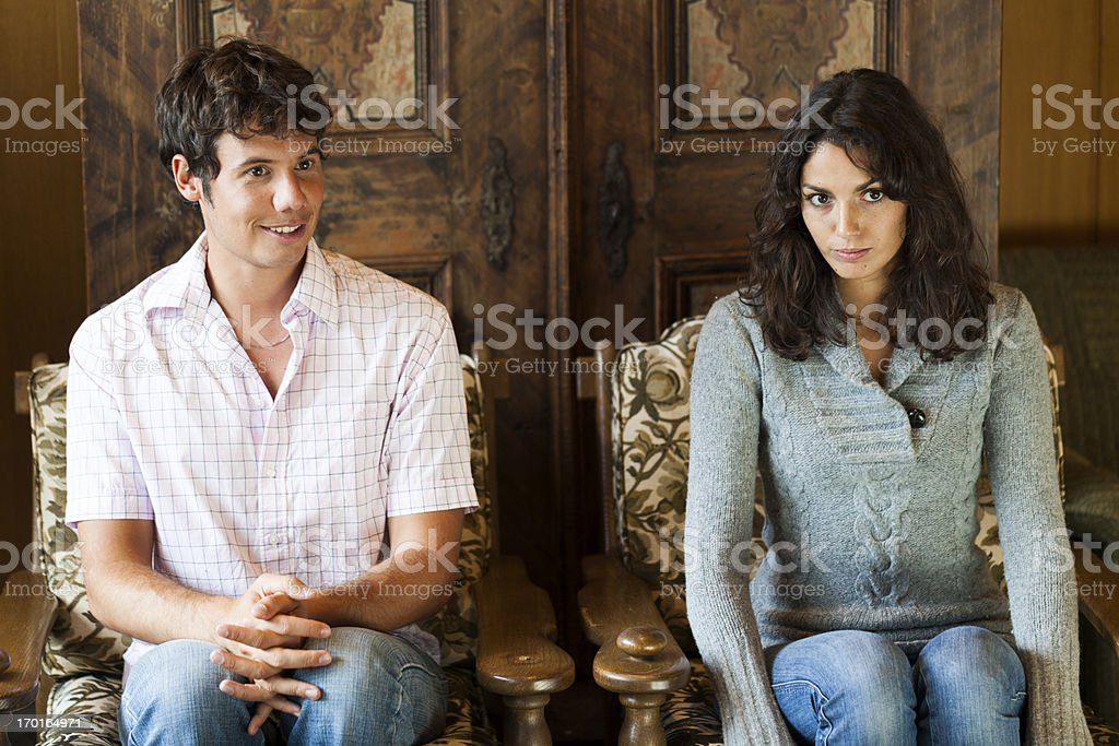 Man sitting besides a shy girl royalty-free stock photo