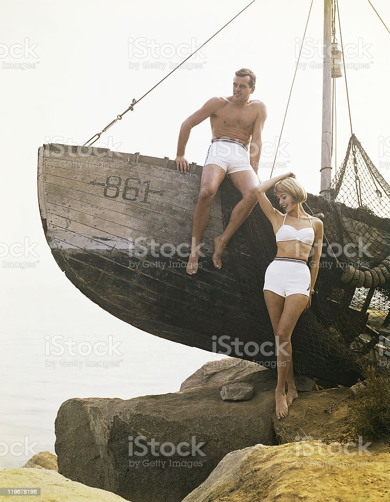 Man sitting boat, woman standing beside  royalty-free stock photo