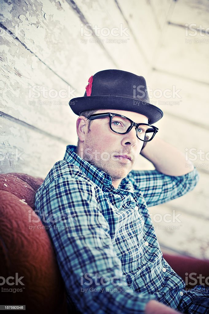 Man sitting in a abandoned barn royalty-free stock photo