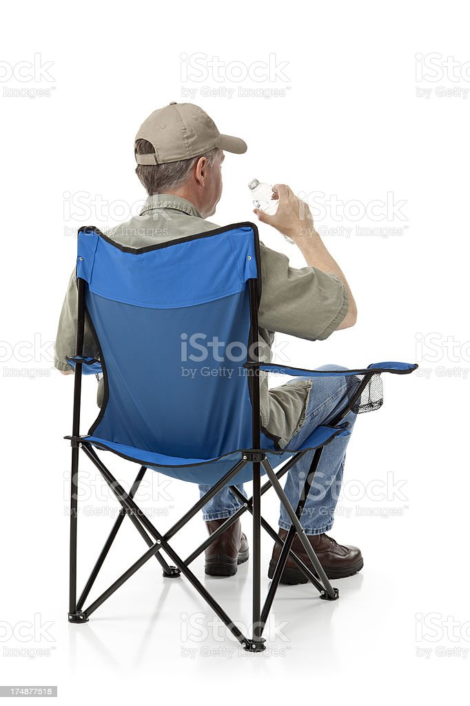 Man Sitting in a Folding Chair royalty-free stock photo