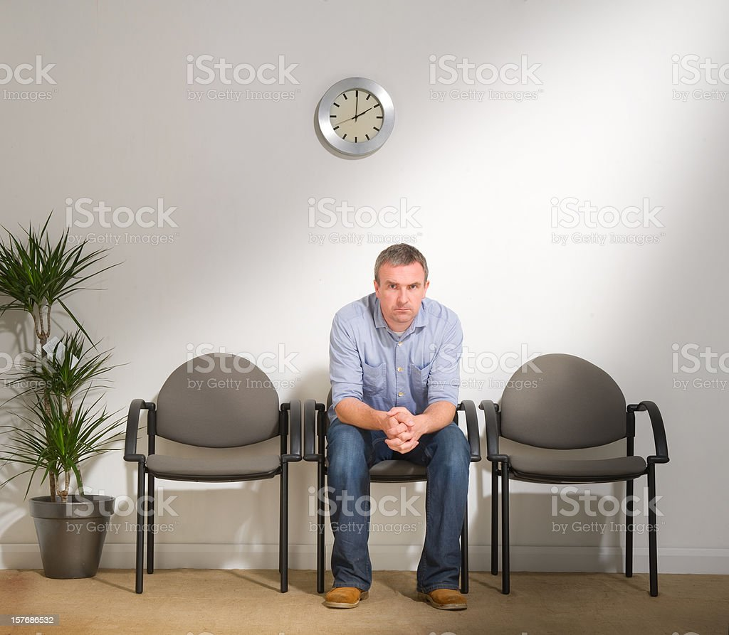 Man Sitting in a Waiting Room royalty-free stock photo