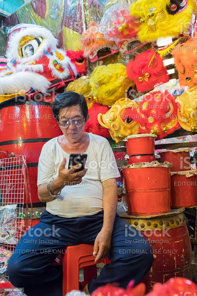 Man sitting in front of his stand stock photo