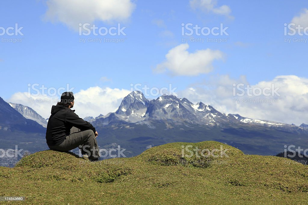 Man Sitting in front of Lake and Mountains royalty-free stock photo