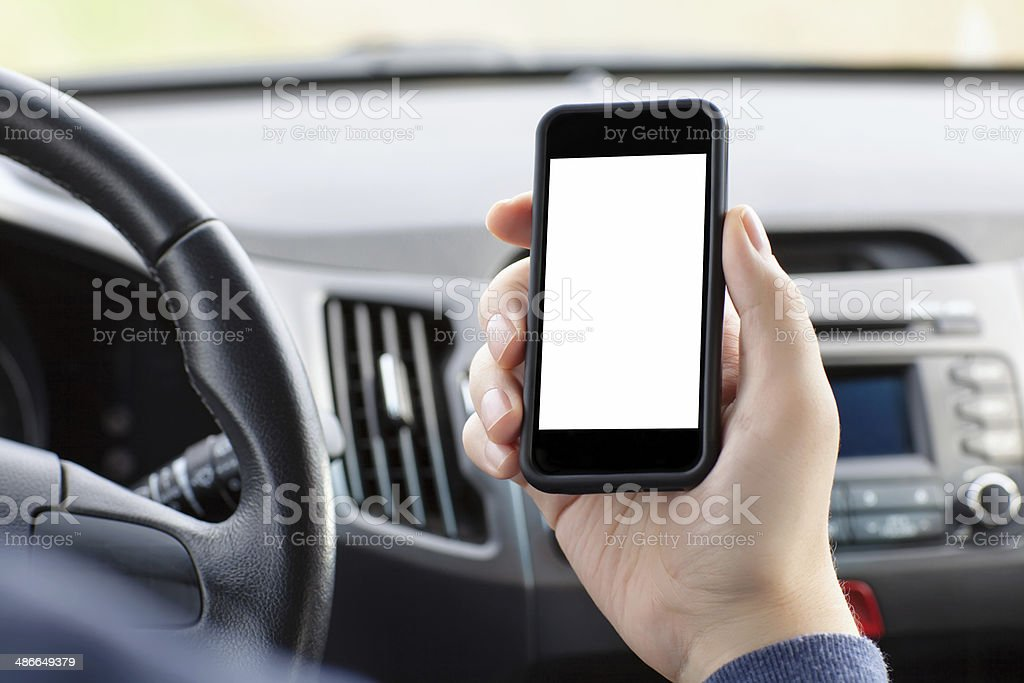 man sitting in the car and holding a phone stock photo
