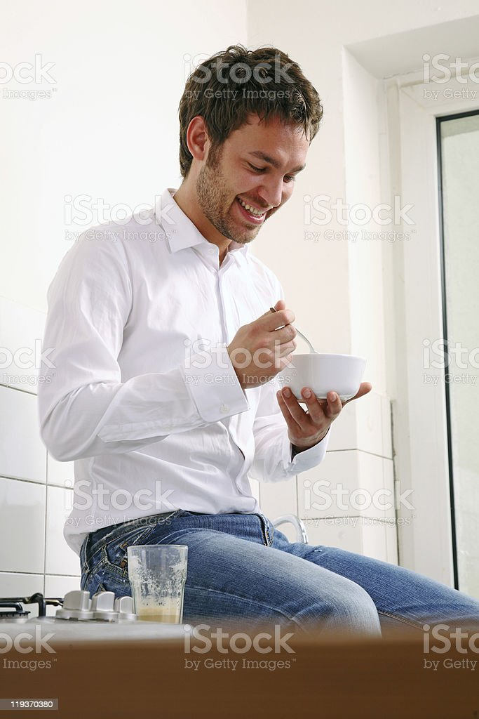 man sitting in the kitchen and have breakfast royalty-free stock photo