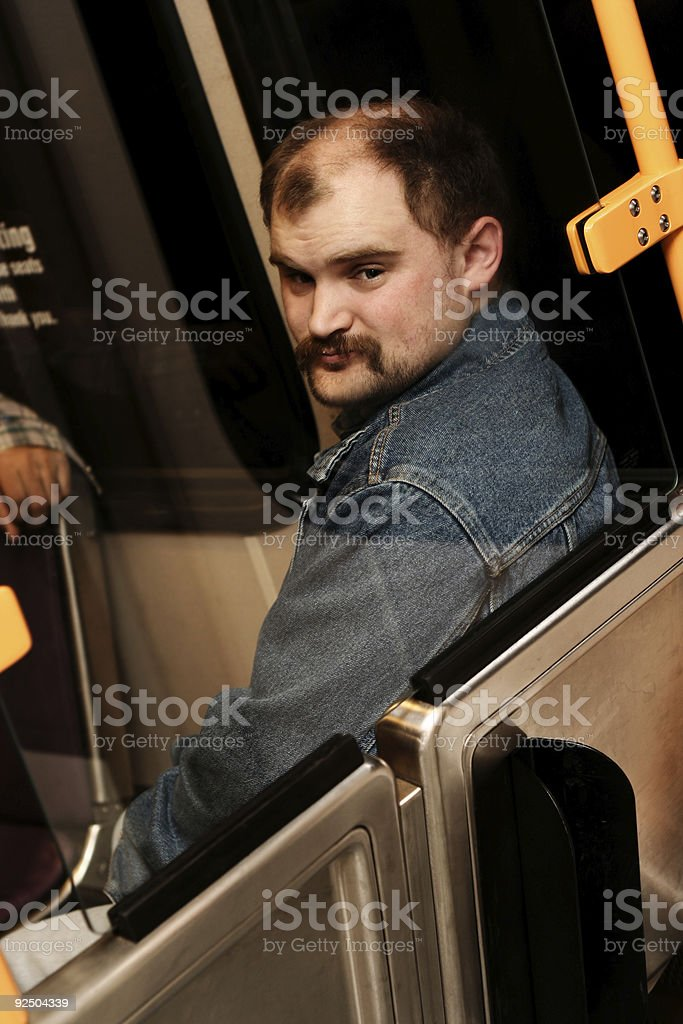 Man Sitting on a Bus Looking Behind Him royalty-free stock photo