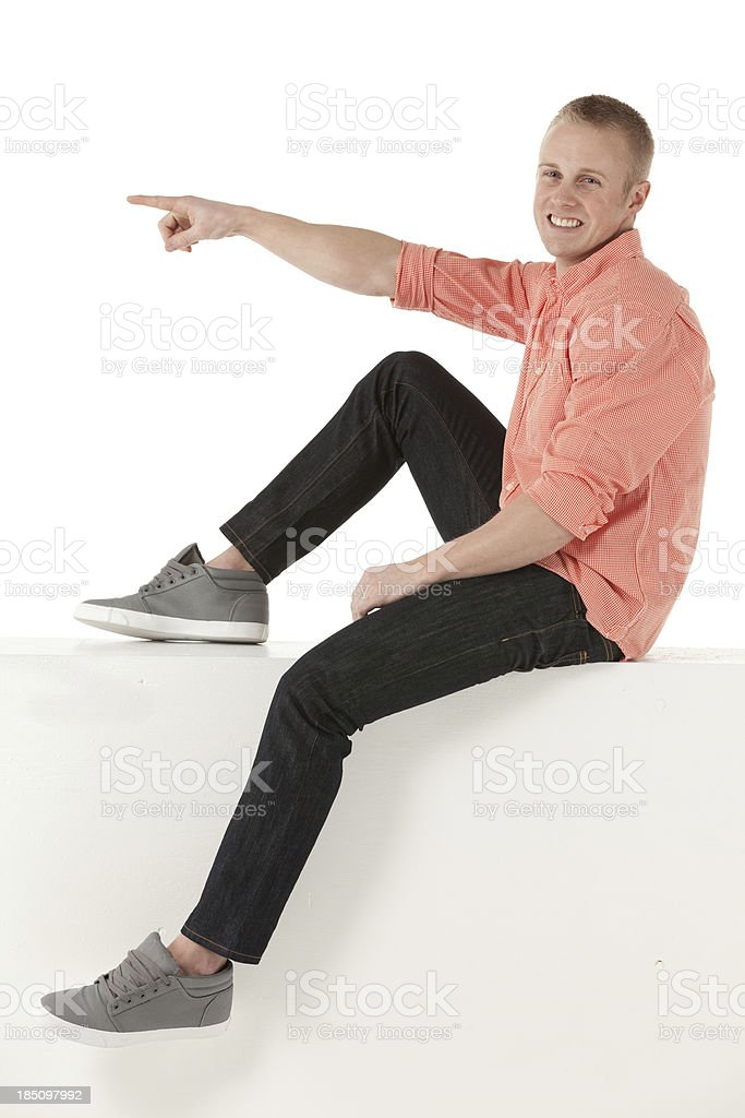 Man sitting on a ledge royalty-free stock photo