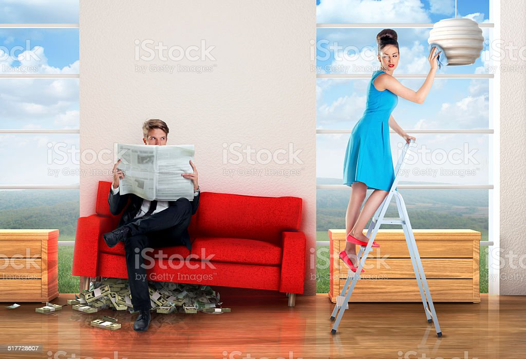 Man sitting on a money pile stock photo