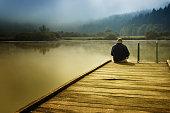 Man sitting on a pier