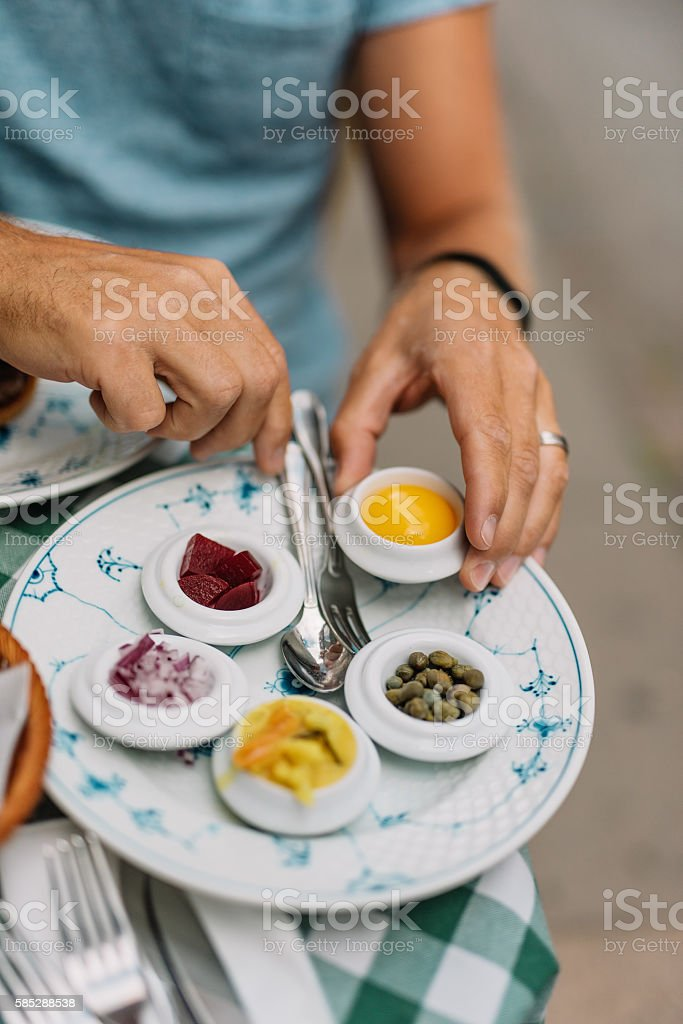 Man sitting on a walkway cafe on summer day stock photo