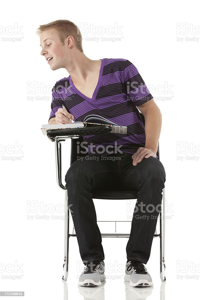Man sitting on a writing chair and looking royalty-free stock photo