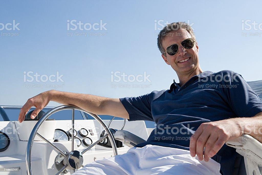 Man sitting on a yacht stock photo