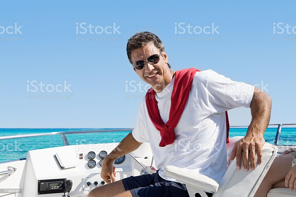 Man sitting on a yacht royalty-free stock photo