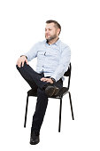 man sitting on chair. open posture, greater influence. Isolated white