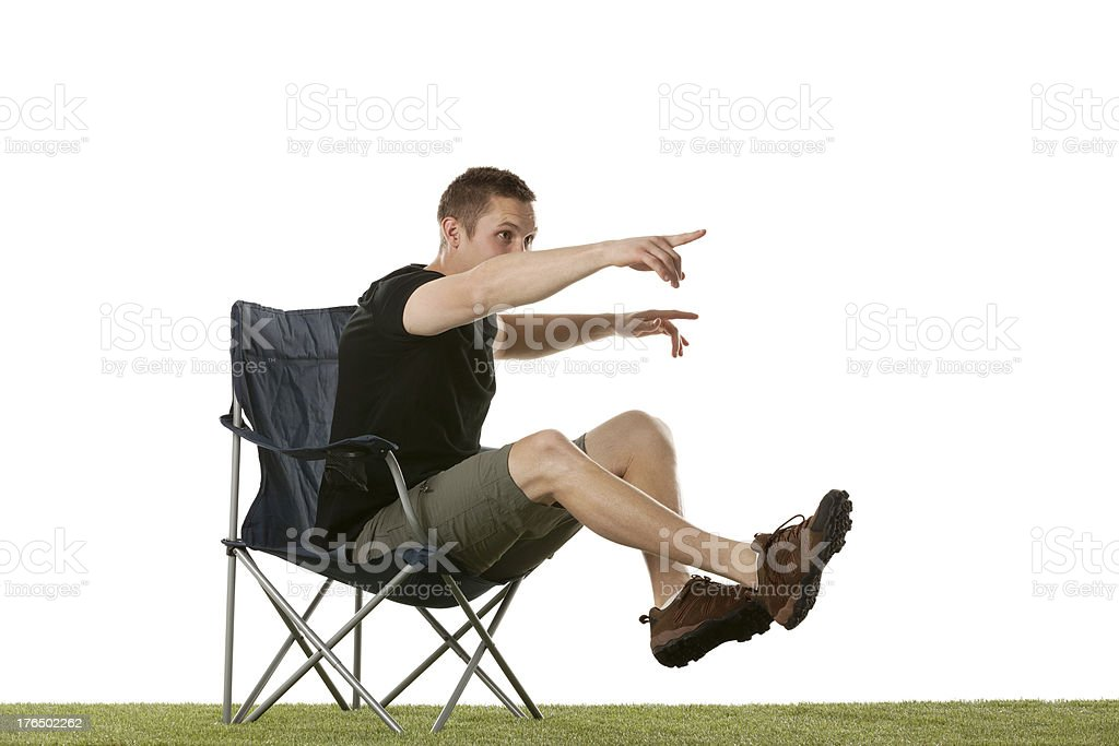 Man sitting on chair pointing away royalty-free stock photo