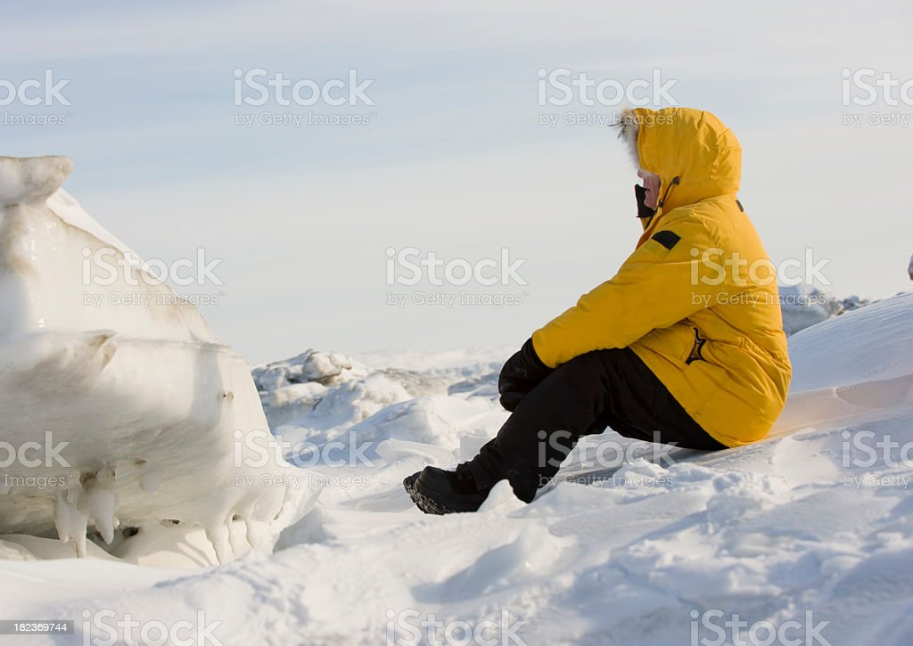 Man sitting on Frobisher Bay, Baffin Island. stock photo