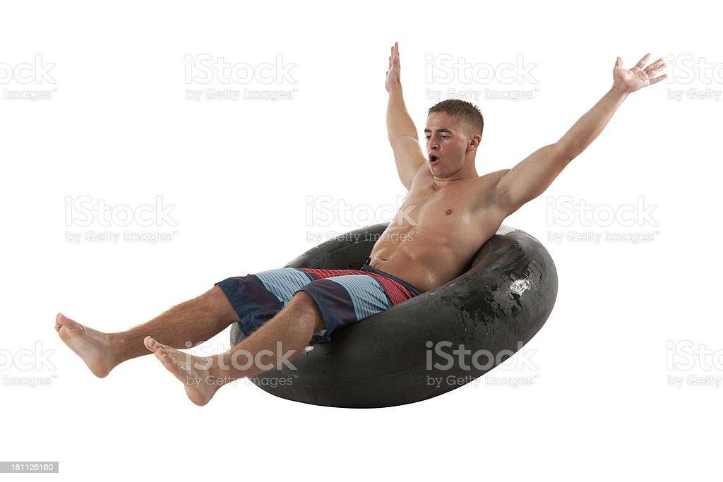 Man sitting on inner tube royalty-free stock photo