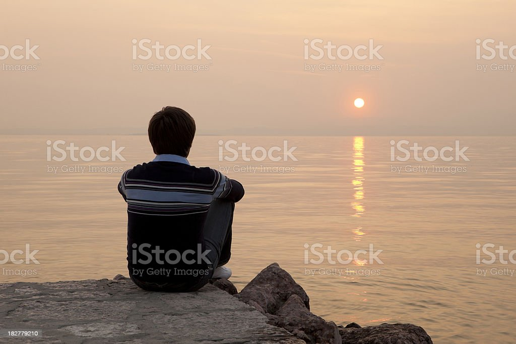 Man sitting on jetty royalty-free stock photo