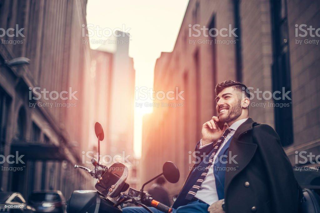 Man sitting on motor bike stock photo
