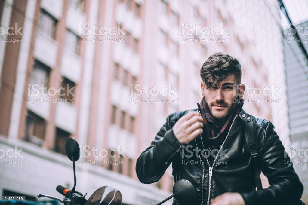 Man sitting on motorcycle stock photo