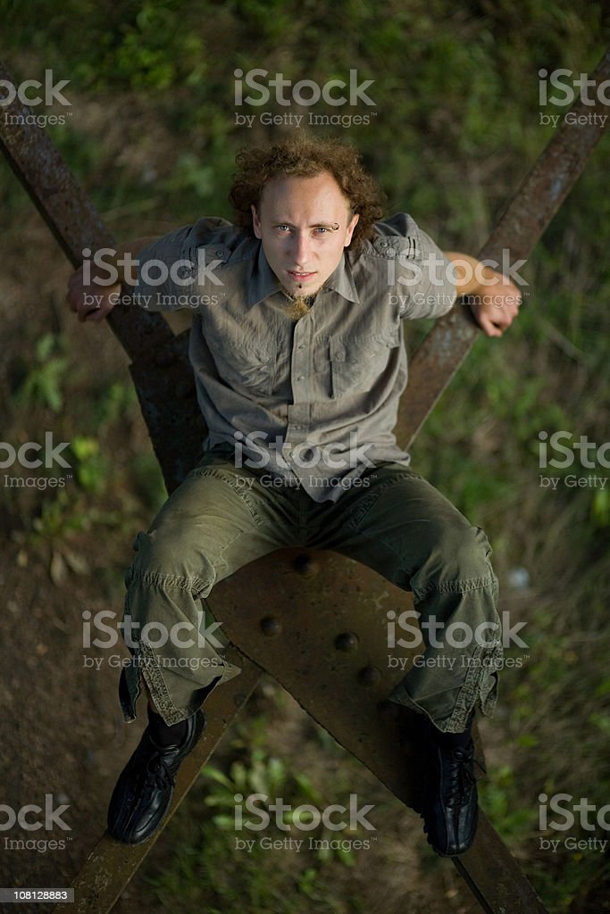 Man Sitting on Rafters Looking up stock photo