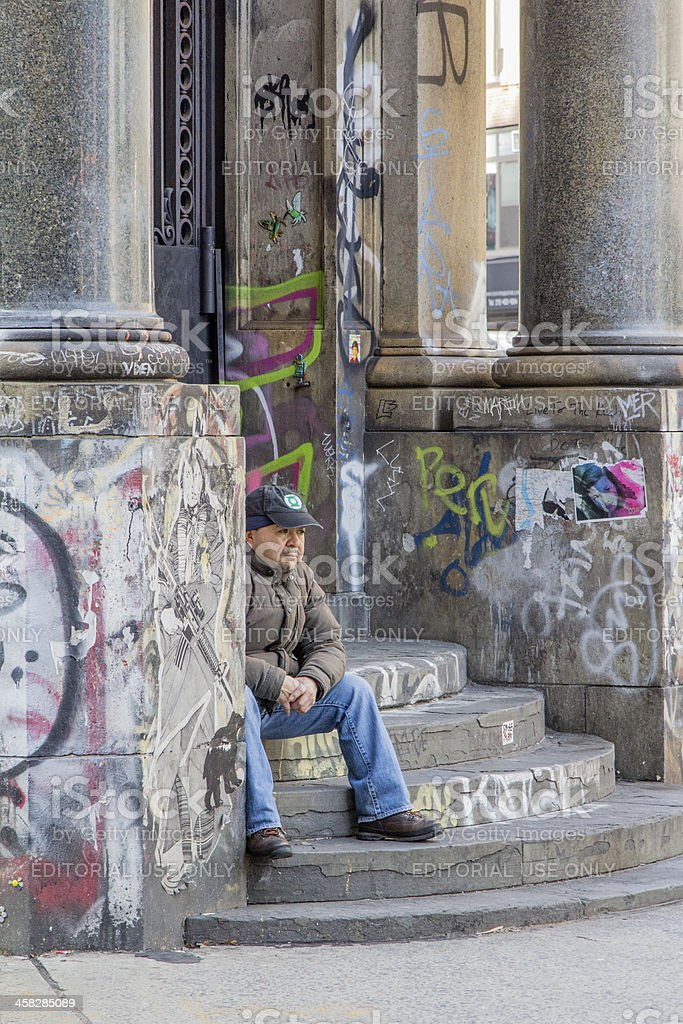 Man Sitting On Steps In New York City royalty-free stock photo