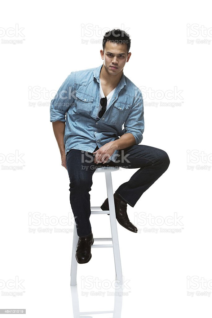 Man sitting on stool with casual clothes royalty-free stock photo