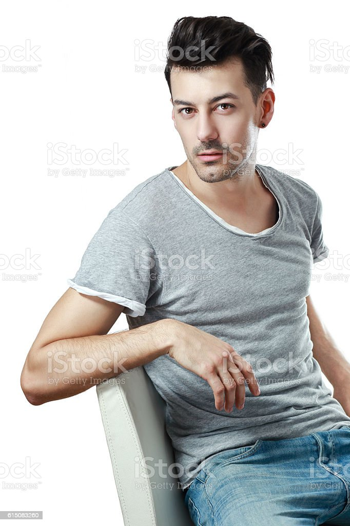 man sitting on the chair stock photo
