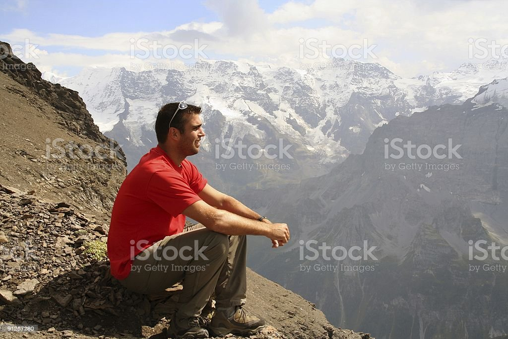 Man Sitting on Top of Mountain and Thinking royalty-free stock photo