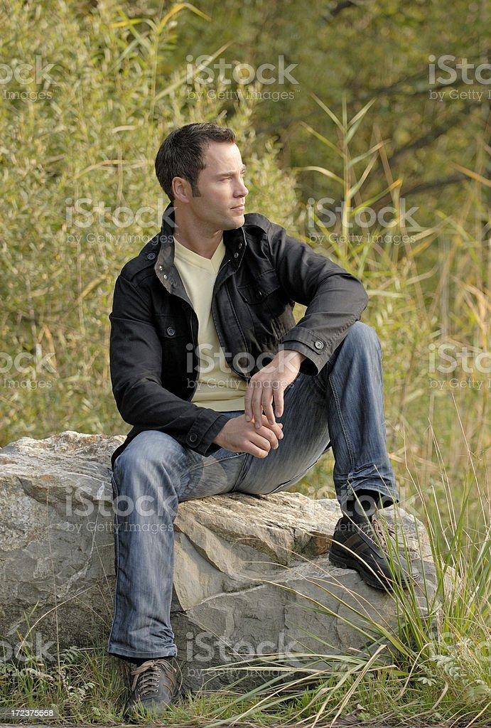 man sitting outside royalty-free stock photo