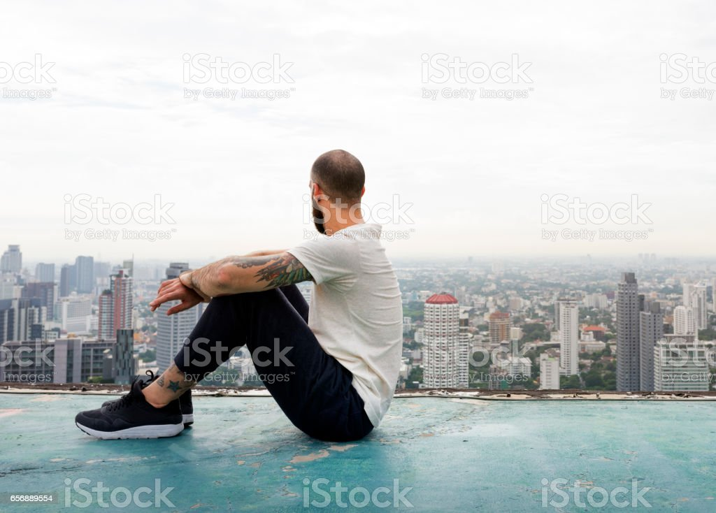 Man Sitting Rest Rooftop Concept stock photo