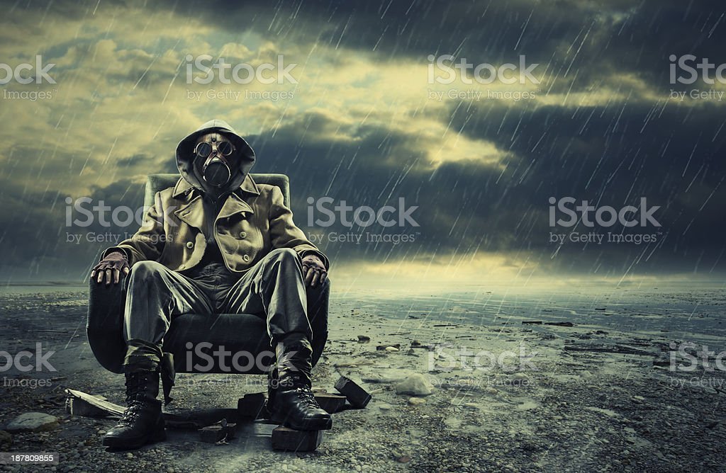 Man sitting with a mask on environmental disaster stock photo