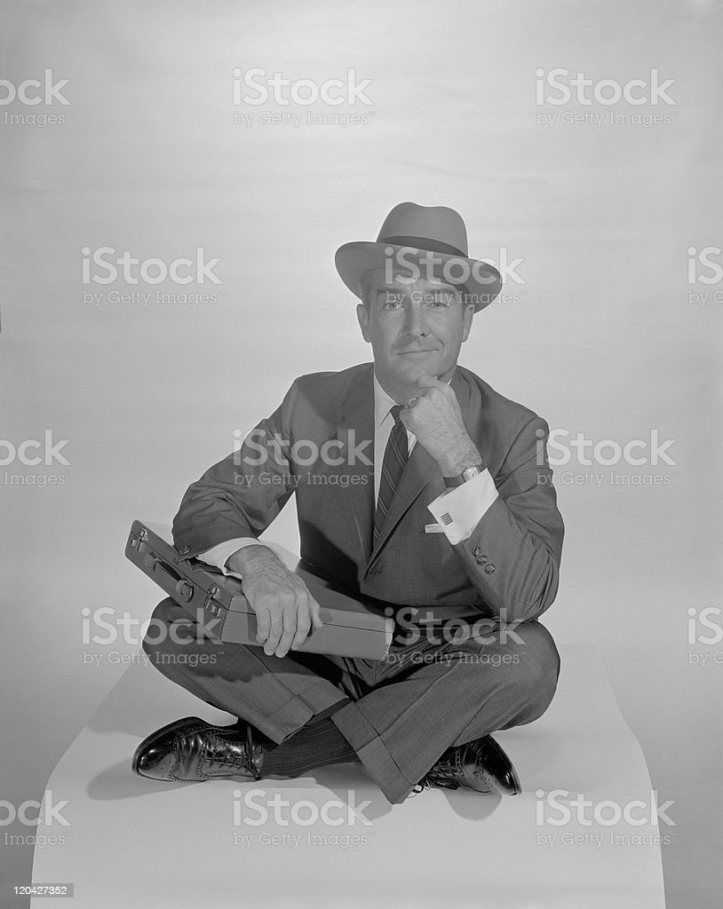 Man sitting with briefcase on lap, portrait royalty-free stock photo