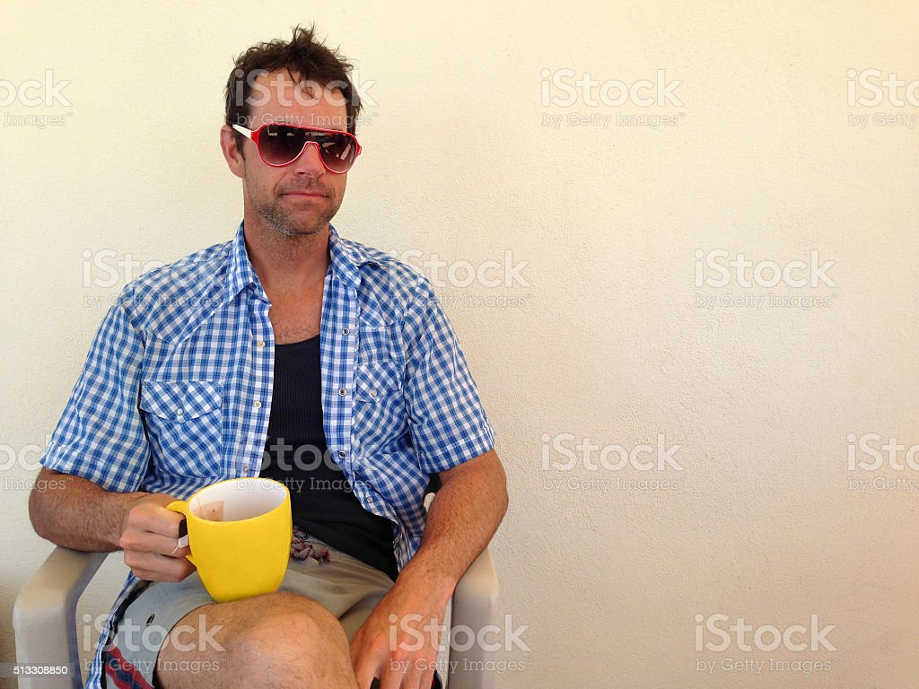 Man Sitting with Coffee Mug in the Morning royalty-free stock photo