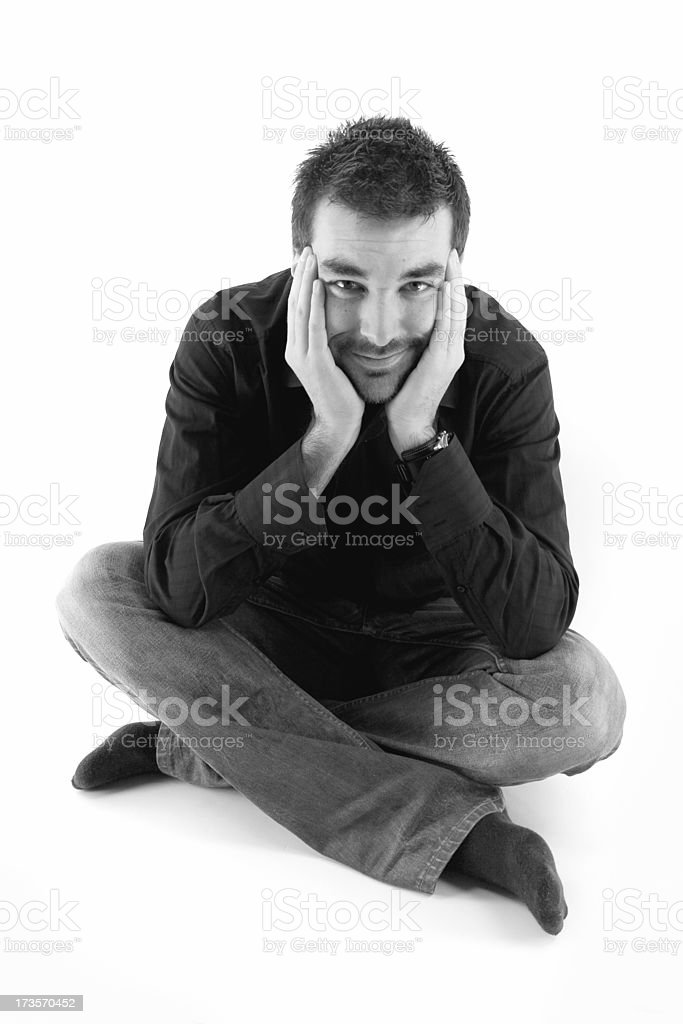 Man sitting with legs crossed stock photo