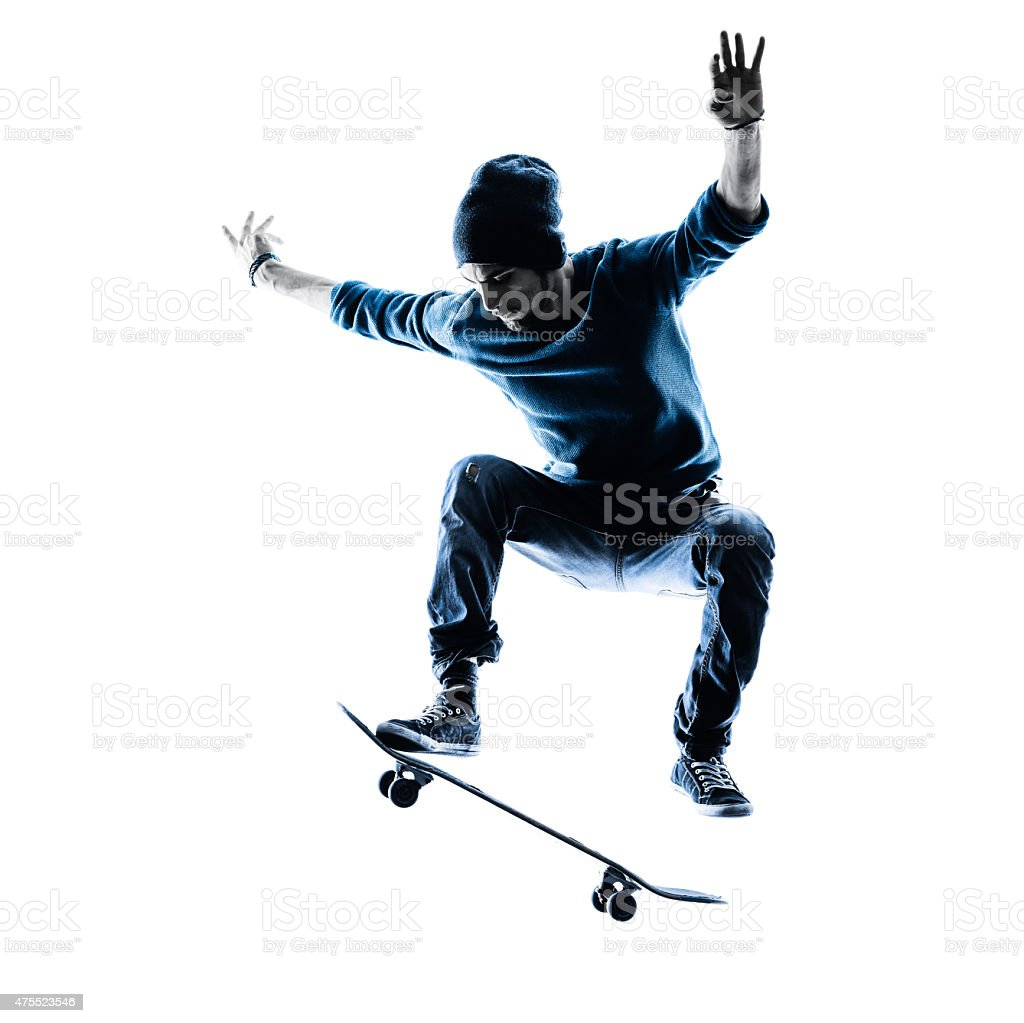 man skateboarder skateboarding silhouette stock photo