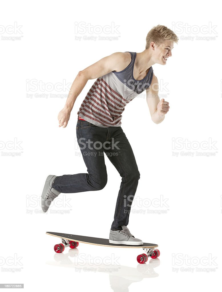 Man skateboarding and smiling royalty-free stock photo