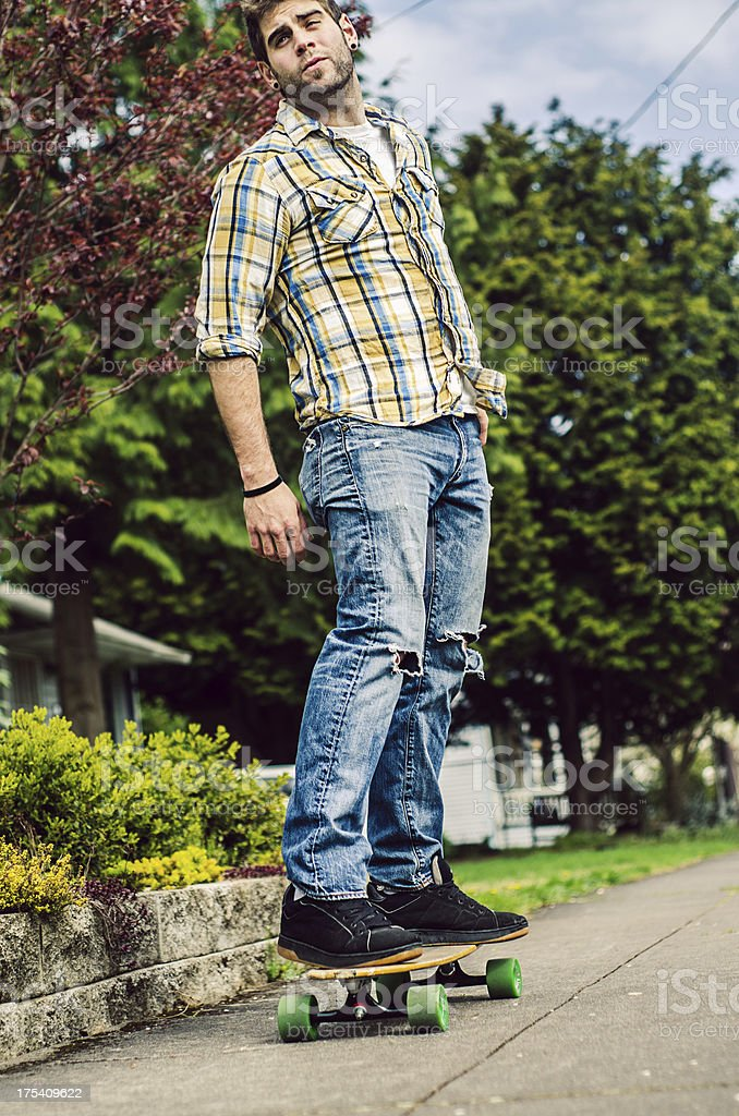 Man skateboarding down the sidewalk royalty-free stock photo